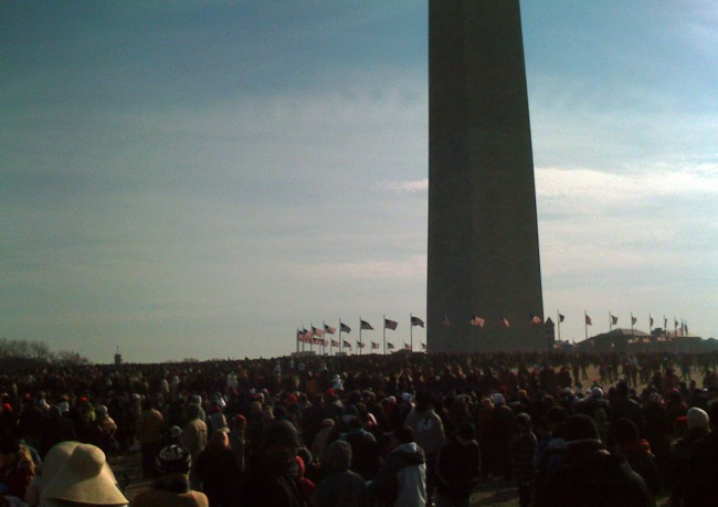 crowds at the base of the washington monument.
